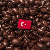 A Turkey flag placed over roasted coffee beans stock image