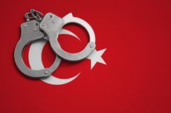 Turkey flag and police handcuffs. The concept of crime and offenses in the country.  stock images