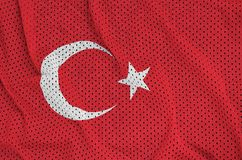 Turkey flag printed on a polyester nylon sportswear mesh fabric. With some folds royalty free stock photo