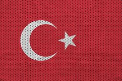 Turkey flag printed on a polyester nylon sportswear mesh fabric. With some folds stock images