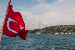 Turkey flag. On sailing along the Bosfor channel boat stock image
