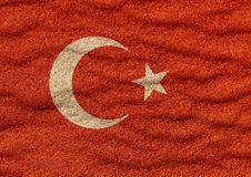 Turkey flag on sand. Turkey flag on surface of sea sand stock illustration