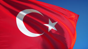 Turkey flag in slow motion seamlessly looped with alpha. Turkey flag waving in slow motion against clean blue sky, seamlessly looped, close up, isolated on alpha stock footage