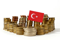 Turkey flag with stack of money coins. Turkey flag waving with stack of money coins stock photography