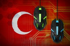 Turkey flag and two mice with backlight. Online cooperative games. Cyber sport team. Turkey flag and two modern computer mice with backlight. The concept of stock photo
