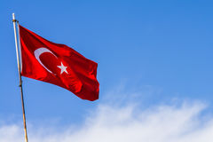 Turkey flag waving in the blue sky Stock Images
