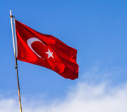 Turkey flag waving in the blue sky.  royalty free stock image