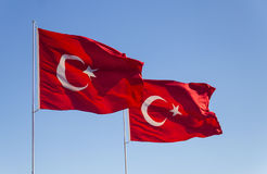 Turkey Flag. Waving flag of Turkey over blue sky background Royalty Free Stock Images