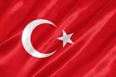 Turkey Flag. With waving on satin texture stock images