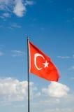 Turkey flag waving under sunny blue sky. Stock Photography