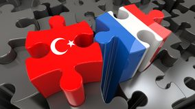 Turkey and France flags on puzzle pieces. Political relationship concept. 3D rendering Royalty Free Stock Images