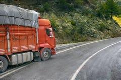 Heavy-duty trucks on a mountain road stock image