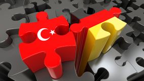 Turkey and Germany flags on puzzle pieces. Political relationship concept. 3D rendering Royalty Free Stock Images