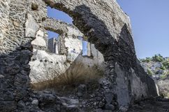 Turkey, the ghost town of Kayak, a close-up view of a ruined house,. Inside the house a shrub grows Stock Images