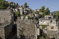 Turkey, the ghost town Kayakei, on the slope of the mountain abandoned houses,. In the foreground stone-paved street Stock Photography
