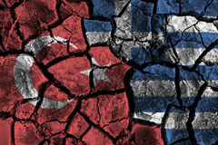 Turkey and Greece flag on cracked ground . Confliction and crisis concept. Royalty Free Stock Image