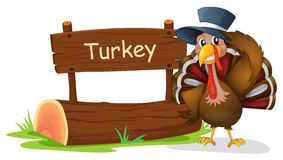 A turkey with a hat beside a signboard Royalty Free Stock Images