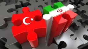Turkey and Iran flags on puzzle pieces. Political relationship concept. 3D rendering Stock Images
