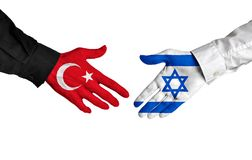 Turkey and Israel diplomats shaking hands for political relations. Hands of two important leaders with national flags for the countries of Turkey and Israel Stock Photography