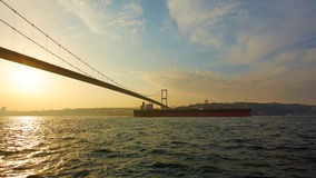 Turkey, Istanbul, Bosphorus Channel, Bosphorus Bridge, an cargo ship under the Bridge. stock photo