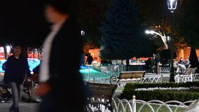 Turkey Istanbul Fountain October 2017. A night fountain in the square, People walk around the fountain in the park.Bright colorful. Holy Sofia stock video
