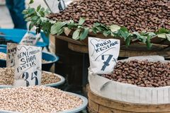 Fresh chestnuts and nuts in bags with price tags on the Egyptian market. Royalty Free Stock Photo