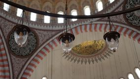 Inner part of the large dome in the structure of the Suleymaniye Mosque. Turkey, Istanbul - 5 June 2019: inner part of the large dome in the structure of the stock video footage