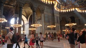 Interior of the old mosque of Hagia Sophia. Turkey, Istanbul - 5 June 2019: interior of the old mosque of Hagia Sophia where a large number of tourists go and stock footage