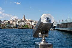 Free TURKEY, ISTANBUL - May, 2020. Tourist Sightseeing Binoculars And Panoramic View To Galata Tower, Galata Bridge Istanbul Stock Photography - 183895132