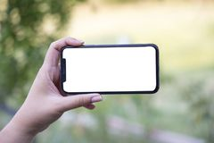 Turkey, Istanbul - September 15.2018: Hands on experience on blank white screen. Reviewing blank white screenapplication. Showin. Showing blank white screen on royalty free stock photo