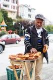Turkey, Istanbul 10.22.2016 - Turkish man sells simits on the street stock images