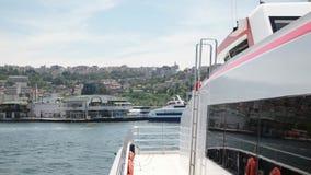 TURKEY - IZMIR - JUNE, 2015: Ferry is getting closer to Konak ferry station. IZMIR - JUNE, 2015: Ferry is getting closer to Konak ferry station stock video