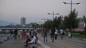 TURKEY - IZMIR - Konak, JULY 2015: Kordon view and people enjoying at city center. IZMIR - Konak, JULY 2015: Kordon view and people enjoying at city center stock video footage