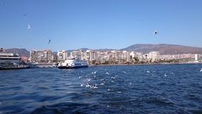 TURKEY - IZMIR - MARCH 1ST, 2015: Ferry seals from Karsiyaka ferry station to carry passengers to city center of Izmir. stock video footage