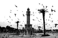 Turkey Izmir Old Clock Tower. Empty Konak Square view with historical clock tower. It was built in 1901 and accepted as the official symbol of Izmir City, Turkey Royalty Free Stock Photo