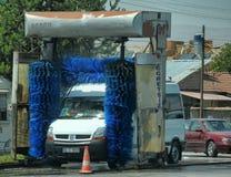 Turkey, Kemer, 15,07,2014 A car in a street car wash. Turkey, Kemer, 15,07,2014 Minibus in a street car wash stock photography