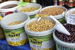 Olives in buckets on the market Stock Images