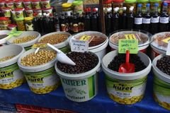 Olives in buckets on the market Stock Image