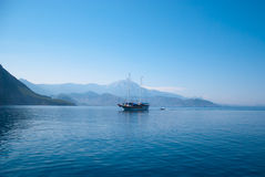 Turkey landscape with blue sea, sky, green hills and mountains. Turkey landscape with boat, blue sea, sky, green hills and mountains. view from the sea Stock Photography
