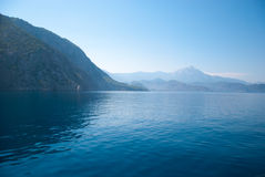 Turkey landscape with blue sea, sky, green hills and mountains. View from the sea Royalty Free Stock Images