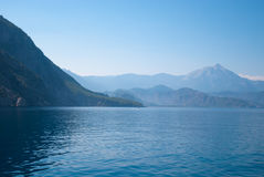 Turkey landscape with blue sea, sky, green hills and mountains. View from the sea Royalty Free Stock Image