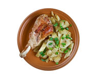 Turkey leg with baked  potatoes Stock Photography