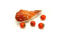 Turkey leg inside vacuum and cherry tomatoes Stock Photos