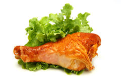 Turkey leg served with green lettuce Stock Image