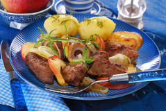 Turkey liver fried with onion and apple Stock Images
