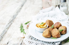 Turkey liver meatballs with caramelized apples Royalty Free Stock Photography