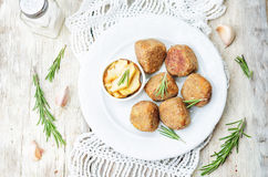 Turkey liver meatballs with caramelized apples Royalty Free Stock Photos
