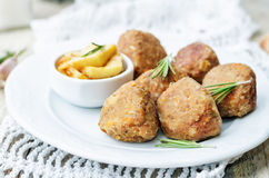 Turkey liver meatballs with caramelized apples Stock Images