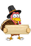 Turkey Mascot - Holding A Wooden sign Royalty Free Stock Images