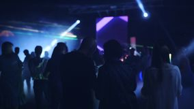 Turkey. May 2019. Dance party under the open sky. Silhouettes of dancing people at the party. Laser show in a nightclub stock video